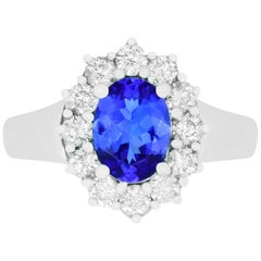 1 Carat Oval Shaped Tanzanite and 0.70 Carat White Diamond Ring