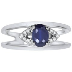 0.93 Carat Oval Cut Sapphire and White Diamond Ring