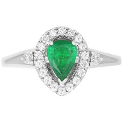 0.51 Carat Pear Shaped Emerald and 0.27 Carat White Diamond Ring