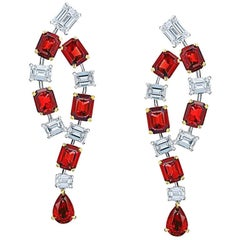 5.67 Carat of Emerald Cut and Pear Shape Ruby and Diamond Earrings