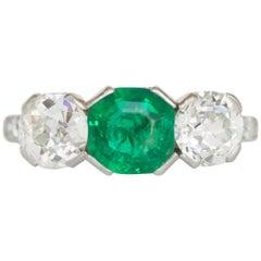 1.00 Carat Emerald and Diamond Platinum Engagement Ring