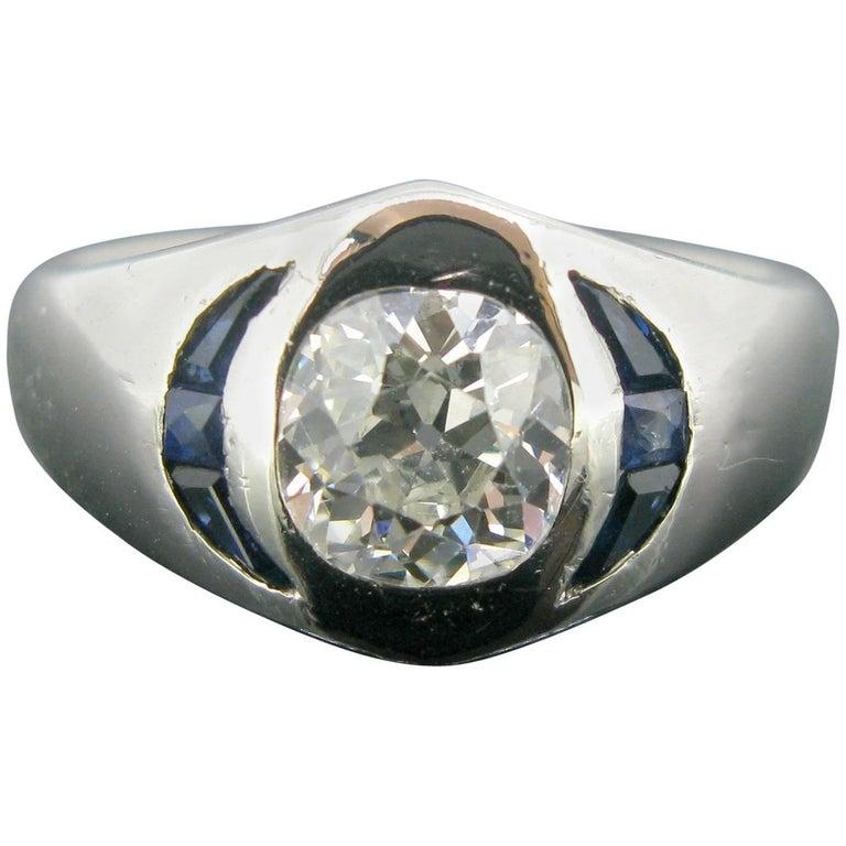 Cushion Cut Diamond and Sapphire Platinum Band Engagement Ring