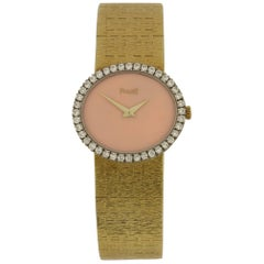Piaget Ladies Yellow Gold Diamond Coral Dial and Bezel Dress Wristwatch