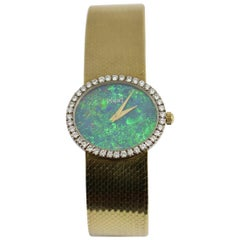 Piaget Ladies yellow gold Diamond Bezel Opal Dial wristwatch