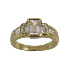 18 Karat Yellow Gold Emerald Cut Diamond Ring