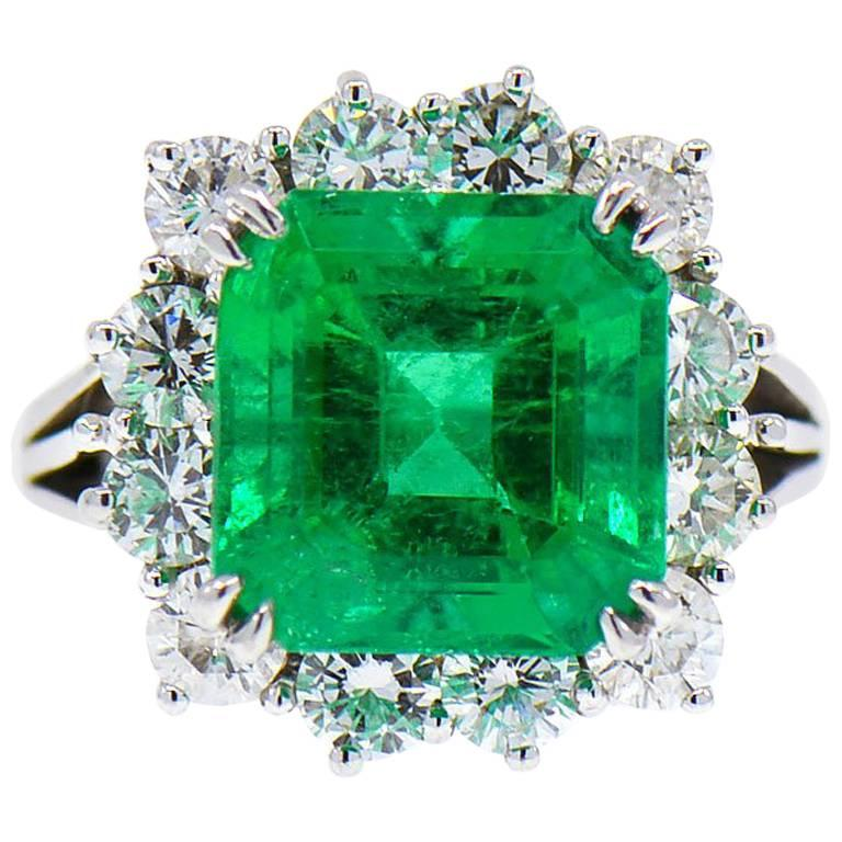 Magnificent 8.50 ct. Fine Colombian Emerald & Diamond Halo Platinum Ring, GIA