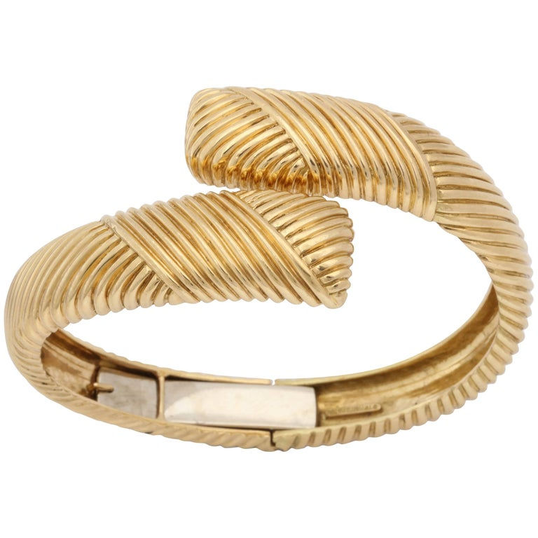 Tiffany & Co. 1960s Stylish Ridge Textured Gold Crossover Hinged Bangle Bracelet
