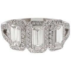 Three-Stone Emerald Cut White Diamond Halo Ring Set in Platinum