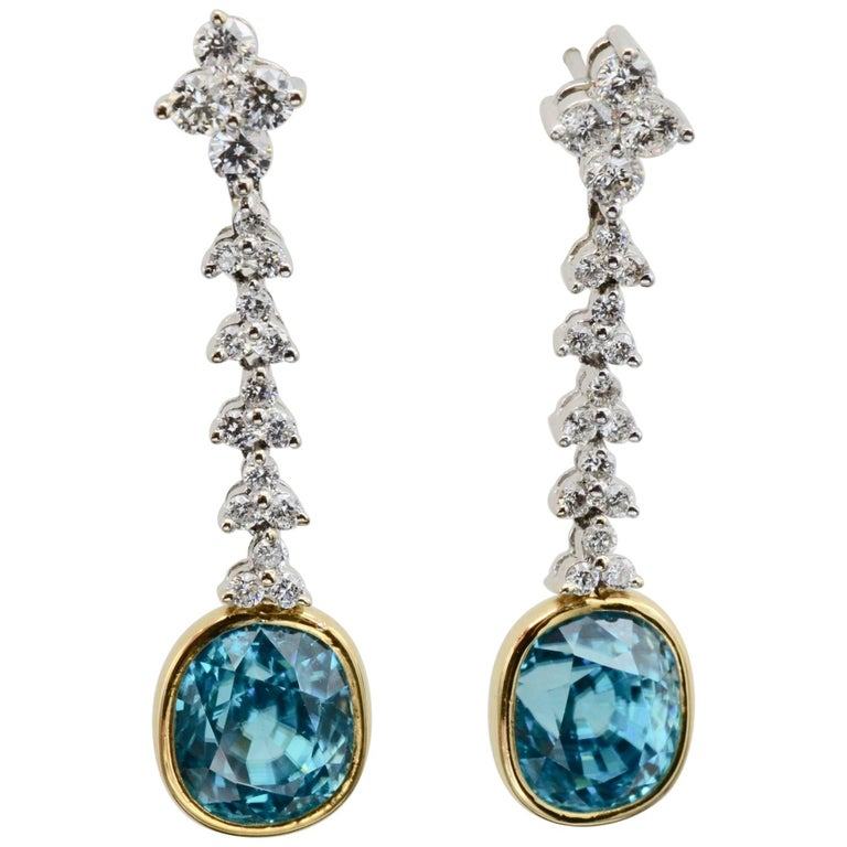 Bright Blue Zircon Post Earrings Dangling from Floral White Diamonds in Gold