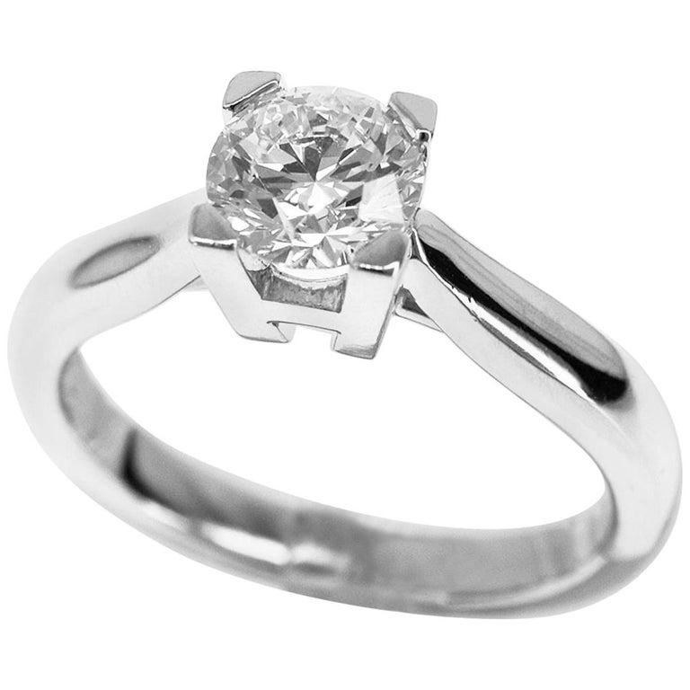 Harry Winston 0.72 Carat Diamond Platinum HW Ring