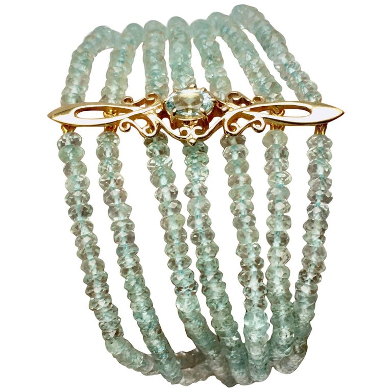 Antique Gold Ornament, Aquamarine Bracelet