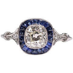 Contemporary Handmade Platinum 1.1 Antique Old Mine Diamond and Sapphire Ring