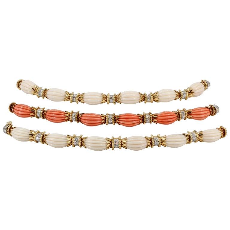 Van Cleef & Arpels Trio Set Diamond, Coral Gold and Platinum Bracelets For Sale