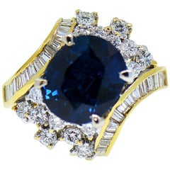 GIA 7.16 Carat Natural Oval Blue Sapphire and Diamond 18 Karat Ring