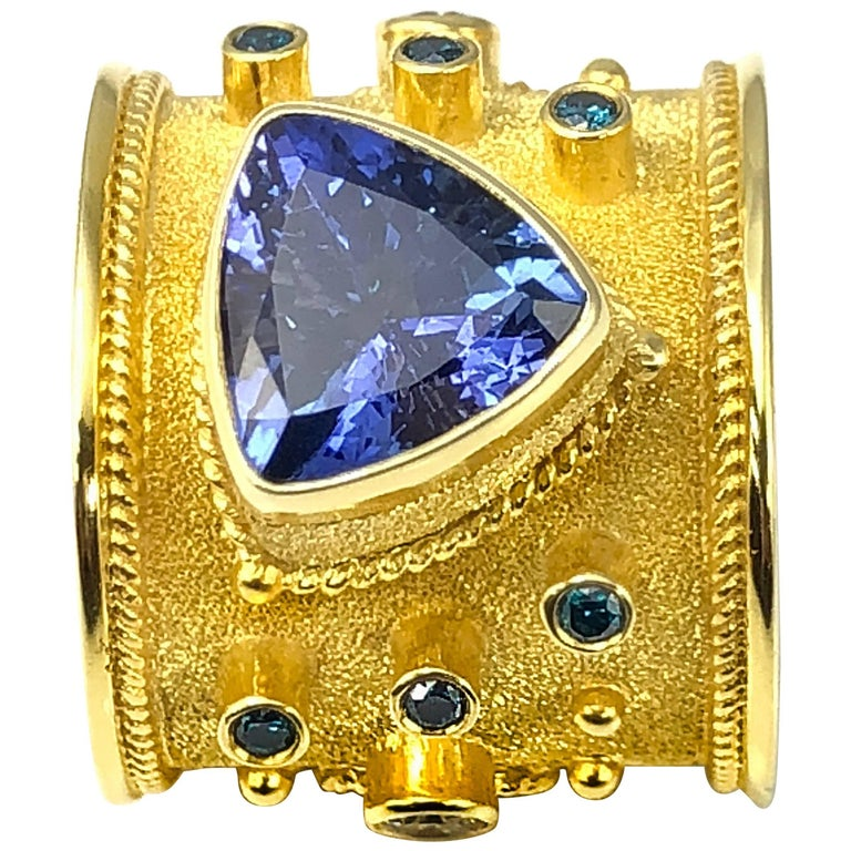 Unique 18 Karat Gold Band Ring with Tanzanite and Diamonds