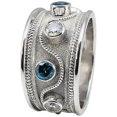 Georgios Collections 18 Karat White Gold Ring with White and Blue Diamond