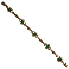 6.40 Carat Emerald 0.50 Carat White Diamond Yellow Gold Bracelet