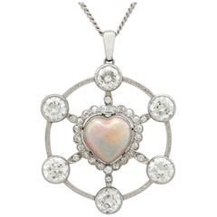 1940s 2.47 Carat Opal and 5.34 Carat Diamond Platinum Pendant