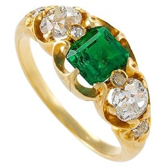 Antique Emerald and Diamond Three-Stone Ring