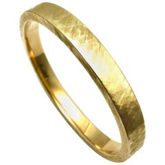 Satin Finish 14 Karat Yellow Gold Bangle Bracelet with a Hidden Clasp