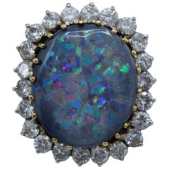 24 Diamond and One Black Opal Ring