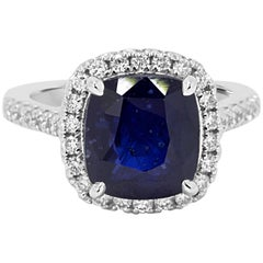 Blue Sapphire Cushion 6.62 Carat Diamond Halo Gold Ring