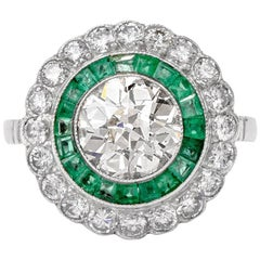 Classic Diamond and Emerald Engagement Platinum Ring