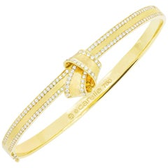 18 Karat Yellow Gold and .71 Carat Diamond Carelle Knot Trim Bangle Bracelet