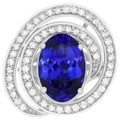 4.90 Carat Oval Shaped Tanzanite and 0.69 Carat White Diamond Ring