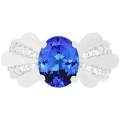 2.75 Carat Oval Shaped Tanzanite and 0.25 Carat White Diamond Bow Ring