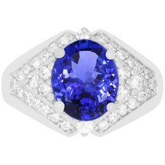 3.43 Carat Oval Shaped Tanzanite and 0.65 Carat White Diamond Ring