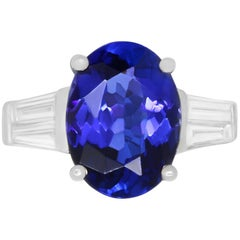 5.22 Carat Oval Shaped Tanzanite and 0.60 Carat White Diamond Baguette Ring