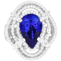 4.64 Carat Pear Shaped Tanzanite and 1.53 Carat White Diamond Ring
