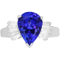 2.73 Carat Pear Shaped Tanzanite and 0.27 Carat White Diamond Baguette Ring