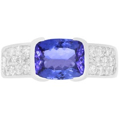 2.95 Carat Emerald Cut Tanzanite and White Diamond Buckle Ring