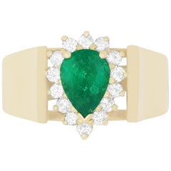 0.80 Carat Pear Shaped Emerald and 0.26 Carat White Diamond Ring