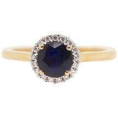 0.69 Carat Round Sapphire Ring and Diamond Ring