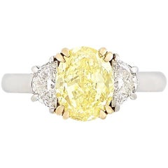 2.50 Carat, Platinum, Gold, Fancy Intense Yellow Diamond and Diamond Ring