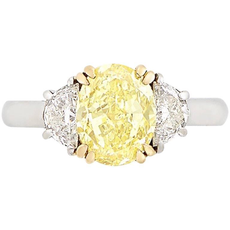 2.50 Carat, Platinum, Gold, Fancy Intense Yellow Diamond and Diamond Ring