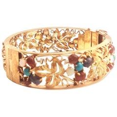 1970s 14 Karat Open Work Bangle Bracelet Opals, Turquoise, Amethyst, Tourmalines