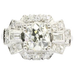 Art Deco Platinum Old European Cut Diamond Cluster Engagement Ring, circa 1920s