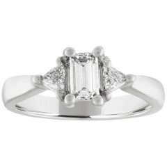 0.71 Carat Emerald Cut Diamond Three-Stone Gold Ring