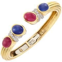 David Webb Gold, Platinum, Cabochon Ruby, Sapphire and Diamond Bangle Bracelet