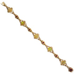 3.50 Carat Opal 0.80 Carat Ruby 0.50 Carat White Diamond Yellow Gold Bracelet
