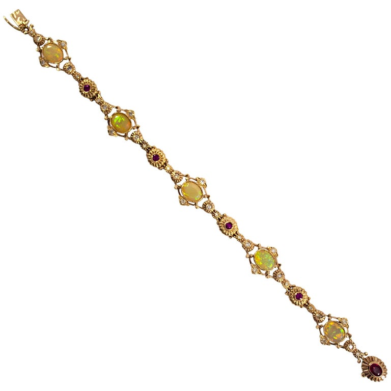 3.50 Carat Opal 0.80 Carat Ruby 0.50 Carat White Diamond Yellow Gold Bracelet