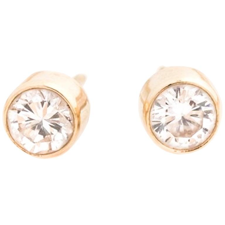 1980s Bezel Set .60 Carat Total Diamond Stud Earrings For Sale