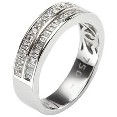 Round and Baguette White Diamonds on White Gold 18 Karat Engagement Ring