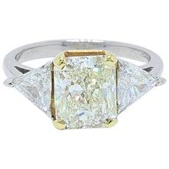 Yellow Radiant Three-Stone 4.00 Carat Diamond Ring in Platinum and 18 Karat Gold