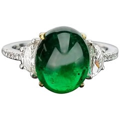 4.80 Carat Emerald Cabochon and Diamond Three-Stone Ring