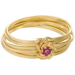 Six Strand 18 Karat Yellow Gold and Ruby Bracelet